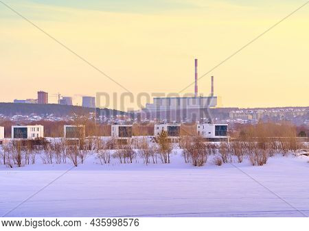 Winter Morning On The Ob. New Residential Area On The Frozen River Bank In Novosibirsk, Heat Station
