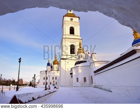 Tobolsk Kremlin In Winter. White Stone Walls Of A High Bell Tower. Old Russian Architecture Of The X