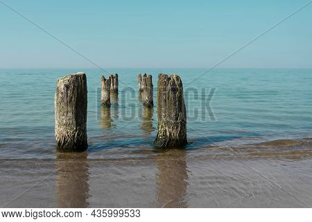 Breakwater On The Beach Of Kolobrzeg On The Polish Baltic Coast