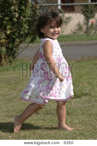Happy Little Girl Running Looking Directly