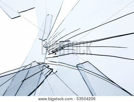 Broken Glass Fragments Above White. Abstract Background Texture