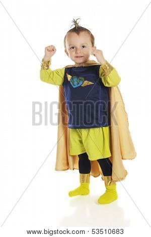 An adorable preschool superhero happily flexing his muscles.  On a white background.