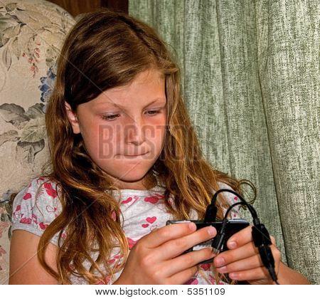 Girl Playing Electronic Game