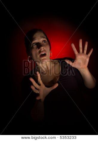 Scared Woman On Dark Background