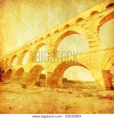 Grunge image of roman aquaduct Pont du Gard in France.