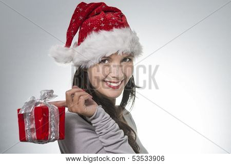 Beautiful Young Woman In A Santa Hat