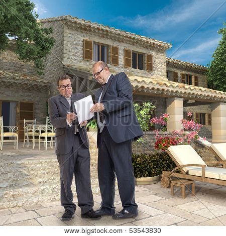 A man forcing another to sign a document by a magnificent villa