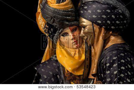 Venetian couple isolated on black
