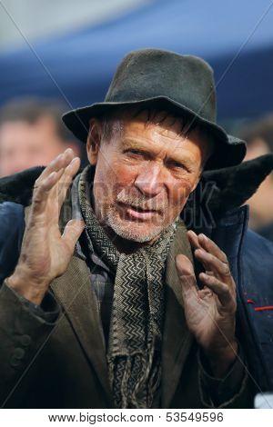 Homeless man gesticulating