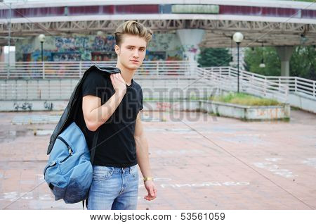 Attractive Blue Eyed, Blond Young Man With Ruck Sack Outdoors