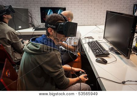 Guys Try A Virtual Reality Headset At Games Week 2013 In Milan, Italy