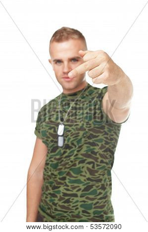 Young Army Soldier Showing The Middle Fingers