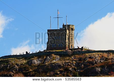 west side of cabot tower top of signal hill and signal cannon - national historical site of canada in st. john's nl. it had important communication and defense role landmark built in 1900. poster