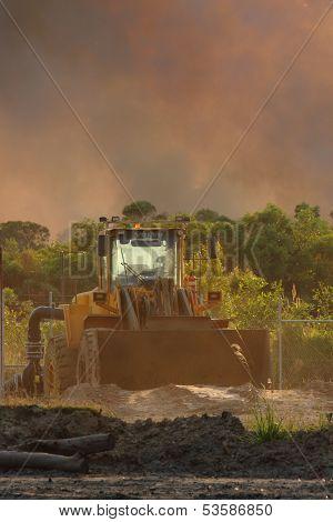 Ningi, Australia - November 9 : Mining Frontend Loader With Backdrop Of Approaching Bushfire Novembe