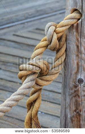 Rope And Knot Attached To Wooden Pole