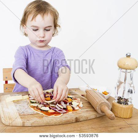 Little Girl Making Fresh Pizza