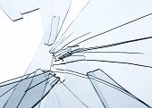 Broken glass fragments above white. Abstract background texture poster
