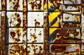 Old rusted industrial trash container with caution tape and handle bars poster