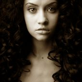 Elegant girl with magnificent curly hair. Studio portrait. poster