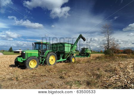 Green Tractor In The Farm Field