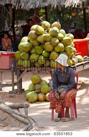 Tradeswoman Of Coconuts At Angkor, Cambodia