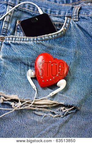 jeans background with  red heart, headphones, telephone poster