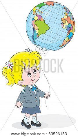 Schoolgirl with a globe - balloon