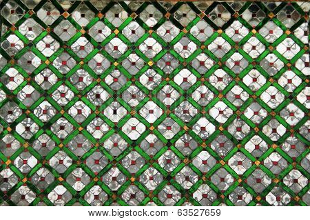 Mirror and Emerald Wall in Wat Phra Keaw Temple of Thailand