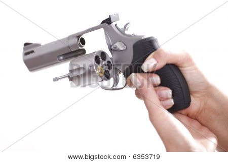Woman Hands With Revolver With Last Shell