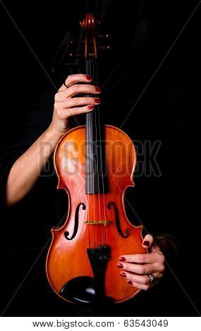 Female Violinist Holds Bow Across Saturated Musical Violin Acoustic Instrument