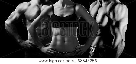 Bodybuilding. Strong man and a woman posing on a black background poster