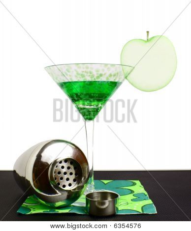 Apple Martini on a bartop with an apple slice