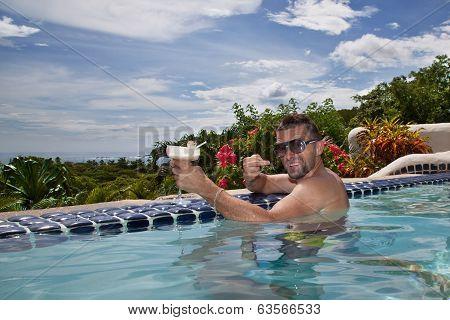 Arrogant man drinking in a pool