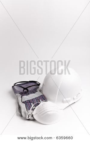 vertical safety gear dust mask hard hat leather gloves and glasses
