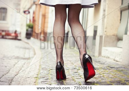 Attractive legs in black high heel shoes