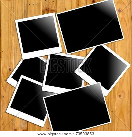 Photo Frames On Wooden Wall Background