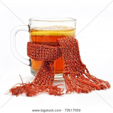 Cup Of Tea In Comforter With Lemon On White Background