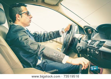 Business Man Driving His Car