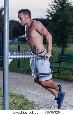 Man Training Triceps Brachii