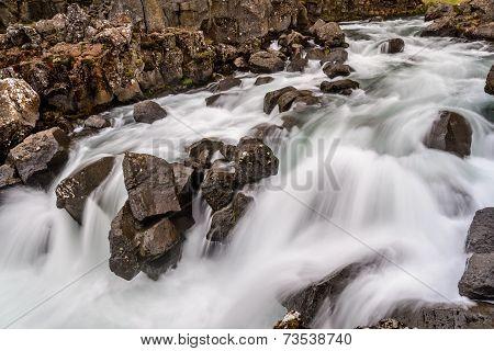 Flowing River Water In Thingvellir National Park, Iceland