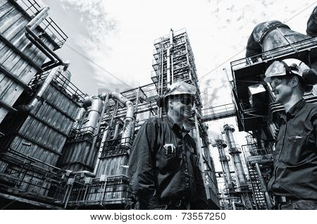 oil and gas engineers inside chemical oil refinery