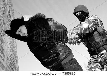 Military Officer Arresting Criminal