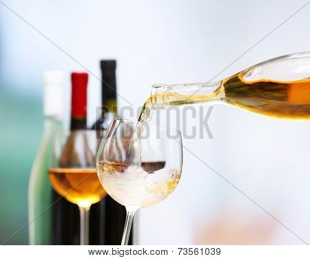 Wine pouring into wine glass, close-up