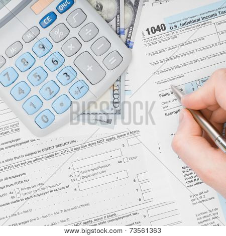 Man Filling Out 1040 Us Tax Form - View From Top