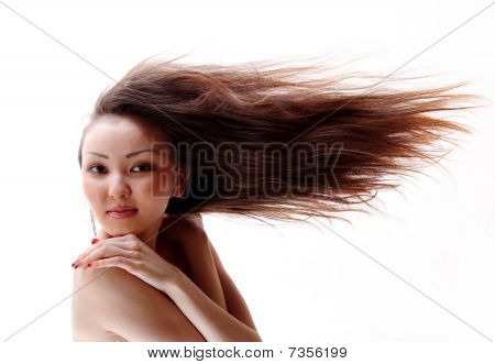 Portrait Of The Asian Girl With A Flowing Hair