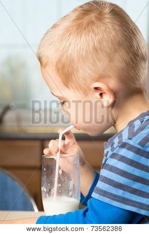 Cute Little Boy Drinks Milk Using A Drinking Straw