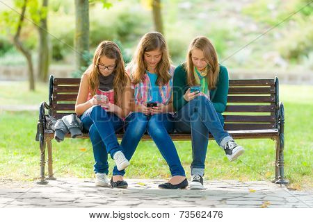 Teen Girls Using Their Mobile Phones