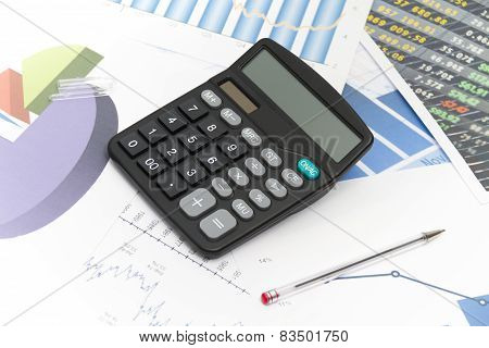 Businessman Analyzing Investment Charts With Calculator And Laptop