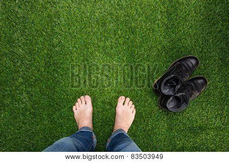 Mens Feet Resting On Green Grass