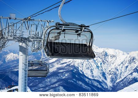 Close view of chairlift and mountains on resort